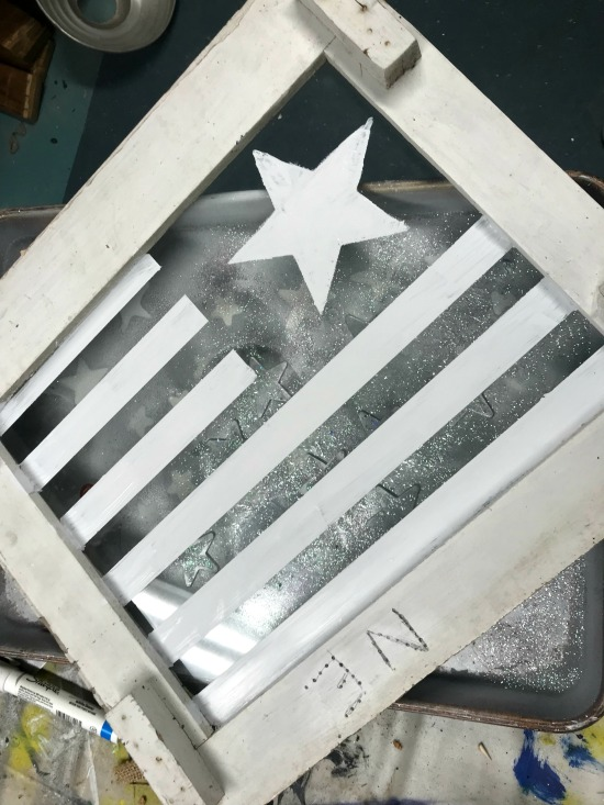 Painting a flag on a Chippy Window with white paint