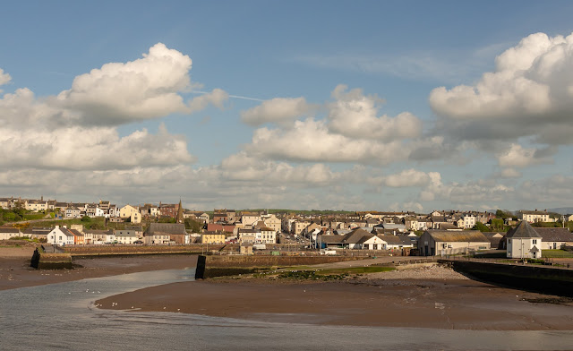 Photo of blue sky and fluffy white clouds over Maryport yesterday