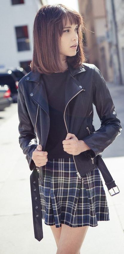 what to wear with a plaid skirt : black top and leather biker jacket