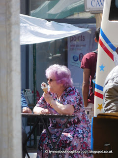 Lady with pink hair eating icecream