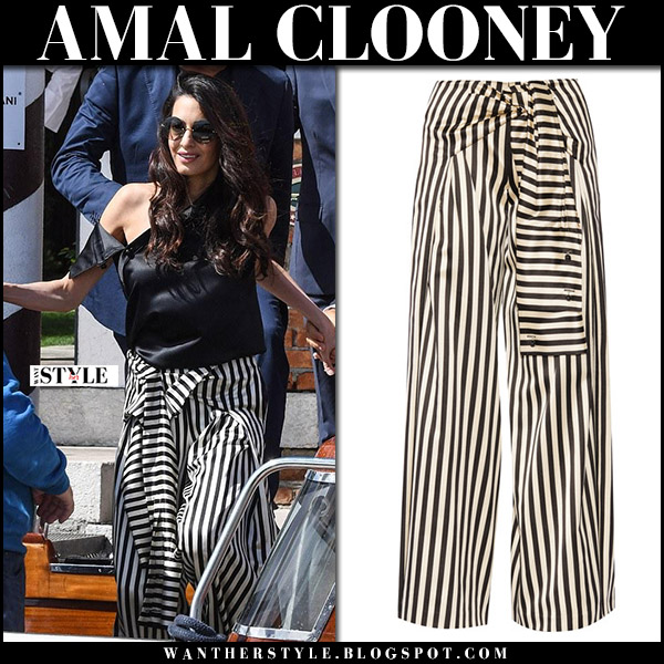 Amal Clooney in black and white striped pants in Venice september 3 2017