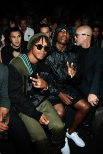 38e8c9b96cce1e A AP Rocky and Lupe Fiasco were seen in front row seats at the Y-3 10th  Anniversary Collection at Fashion Week. Lupe was wearing a pair of fresh  Thom Browne ...