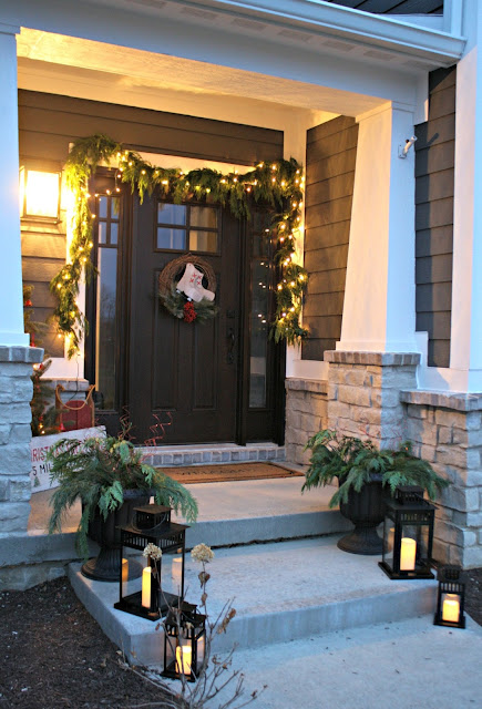 lanterns on front steps outside at Christmas