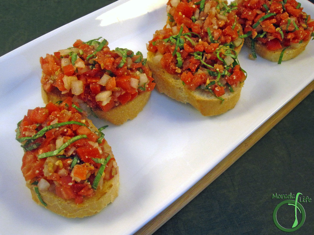 Morsels of Life - Bruschetta - Chopped tomatoes and onion, mixed with basil, balsamic vinegar, garlic, and Parmesan cheese, then piled onto a toasted slice of Italian bread for serving.