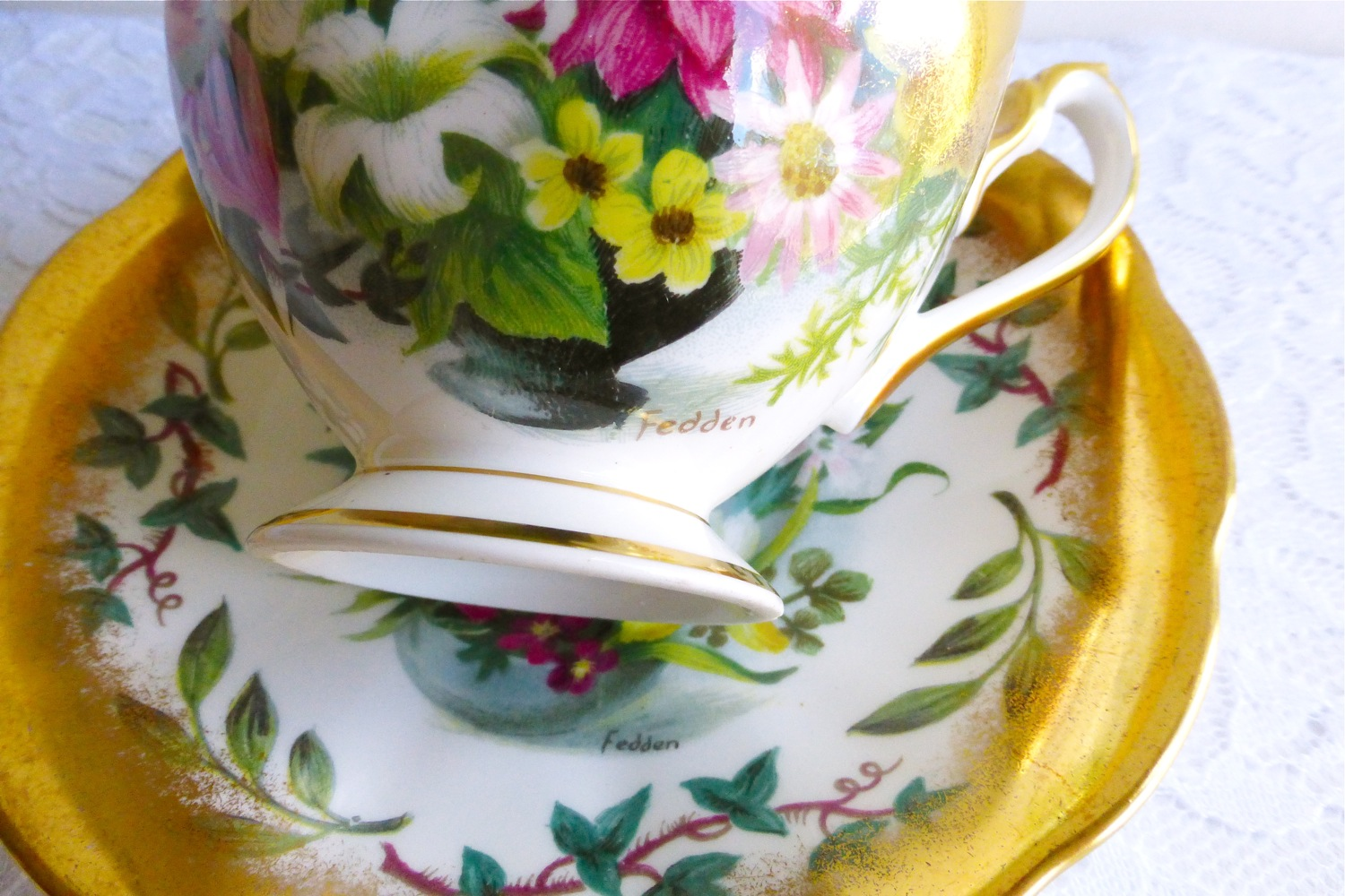vintage Queen Anne 'Fedden' teacup and saucer, vintage teacup and saucer, Mary Fedden teacup and saucer, artist Mary Fedden teacup art, teacup artwork of Mary Fedden, signed Mary Fedden Queen Anne teacup and saucer, Fedden teacup, vintage Fedden teacup and saucer, vintage Queen Anne floral teacup and saucer, vintage Queen Anne gold gilded teacup and saucer, vintage pink floral teacup, vintage yellow floral teacup, vintage ivy teacup, vintage green leaf teacup