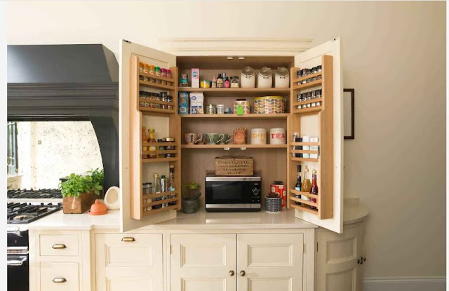 hidden kitchen cabinets and coffee station