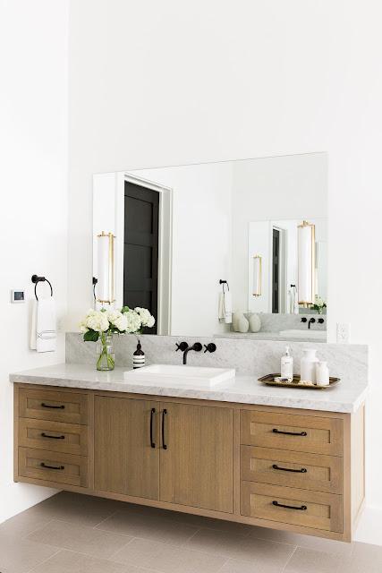 Floating vanity in modern bathroom of mountain home by Studio McGee