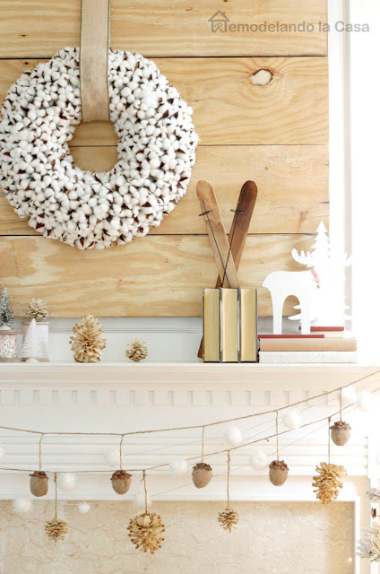 cotton wreath on mantel with wooden tones and pinecones