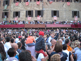 Children on Piazza del Campo in Siena during the Palio horse race