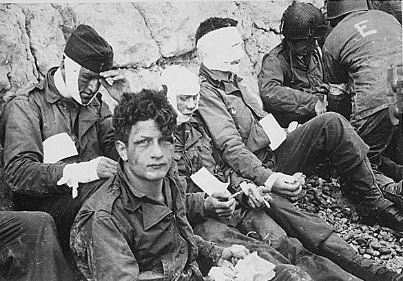 WW2 American soldiers of 16th Infantry Regiment injured storming Omaha Beach--waiting for evacuation to field hospital-Collville-sur-Mer- NormandyWW2 American soldiers of 16th Infantry Regiment injured storming Omaha Beach--waiting for evacuation to field hospital-Collville-sur-Mer- Normandy