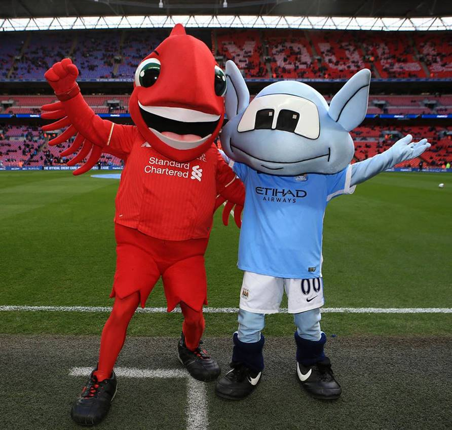 Liverpool-and-Manchester-City-Mascots-stood-on-pitch-arm-in-arm