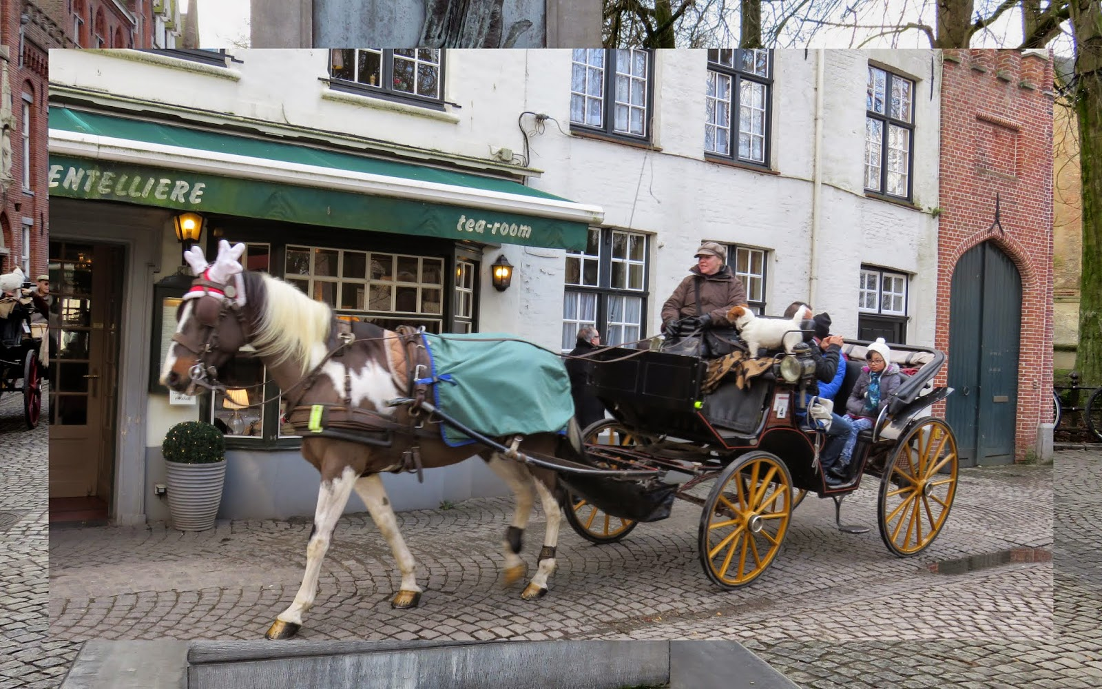 15 Reasons to Visit Bruges for Christmas: Horse-drawn carriage in Bruges