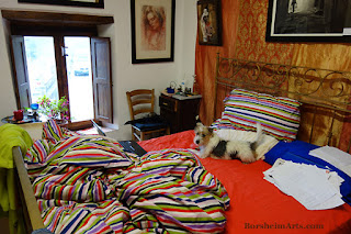 Dog in artist's BED Dogsitting while writing an art newsletter