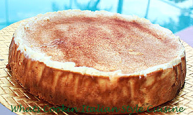 this is how to make a pumpkin cheesecake with a cinnamon graham cracker crust baked. This is an Amaretto Pumpkin Cheesecake with a cinnamon sugar topping. This easy recipe shows you how to make this decadent pumpkin cheesecake step by step. The crust, filling and topping is all baked from scratch using a spring form pan.