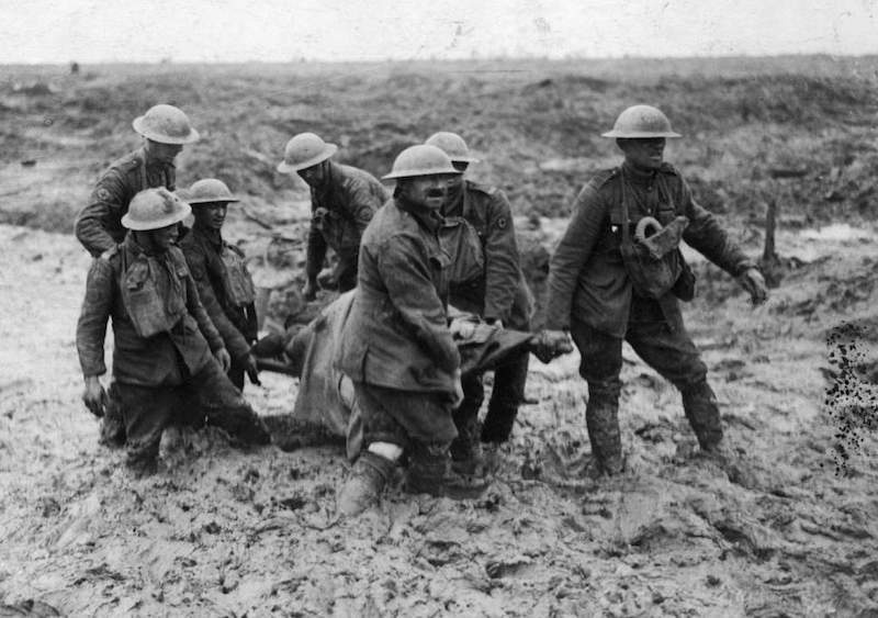 WWI evacuating injured soldier in the mud and rain