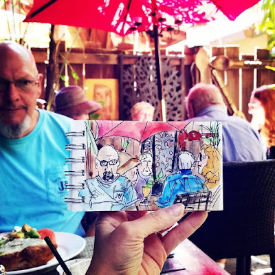 Sketchbook painting in travel journal at the Goblin Market in Mount Dora Florida by Merrill Weber The Good Life of an Artist Blog