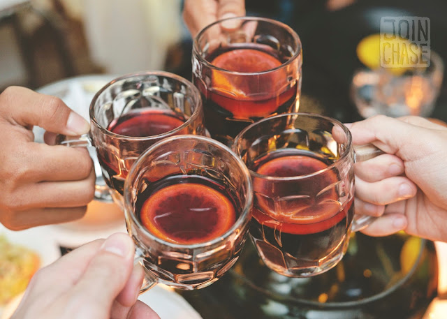 Cheers with four glasses of mulled wine in Yangon, Myanmar.