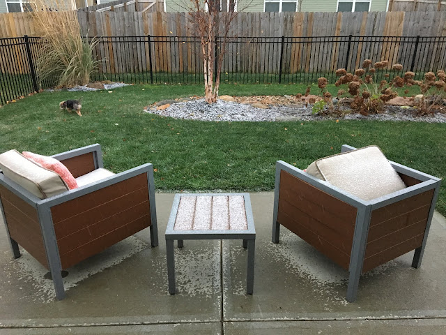dusting of snow on patio furniture