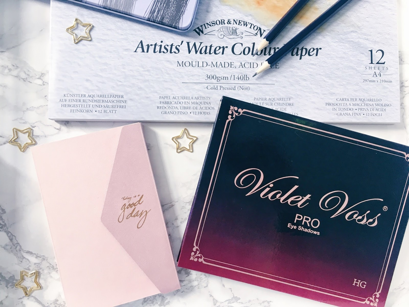 violet voss palette, planner, watercolour pad and star paperclips