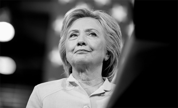 black and white image of Hillary Clinton at a campaign event, with an expression of resolve