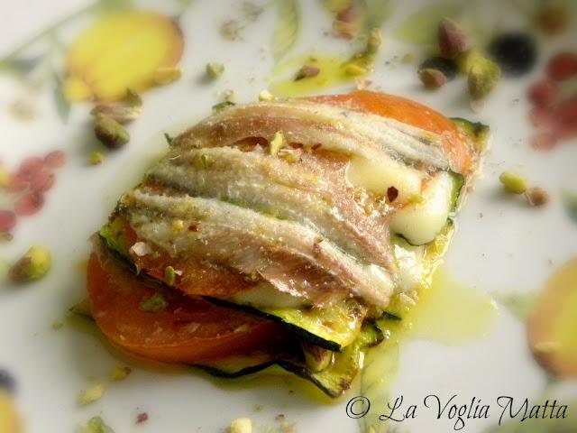 tortino di sardoni con zucchine, pomodori,provola e pistacchi