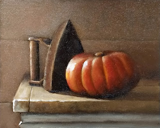 Oil painting of a cast iron iron beside an orange pumpkin.