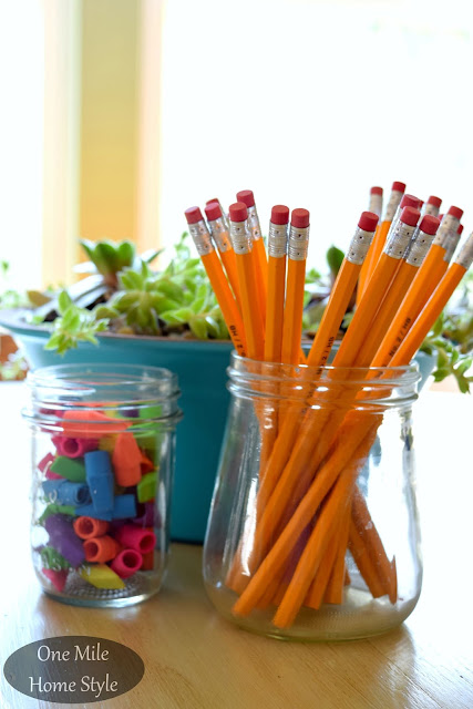 Simple homework station with pencils and erasers stored in glass jars