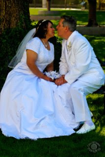 Cramer Imaging's professional wedding portrait of bride and groom sitting on a bench looking at each other at Temple Square, Salt Lake City, Utah