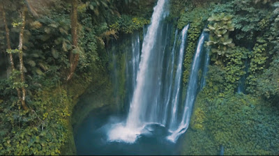 A royalty free of aerial drone shot of - Best popular Secret - Amazing waterfalls in Lombok Indonesia The Tiu Kelep
