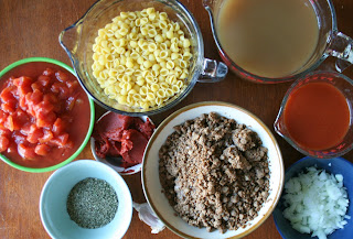 crockpot lasagna soup ingredients: noodles, broth, beef, tomatoes, tomato paste, seasoning, diced onion
