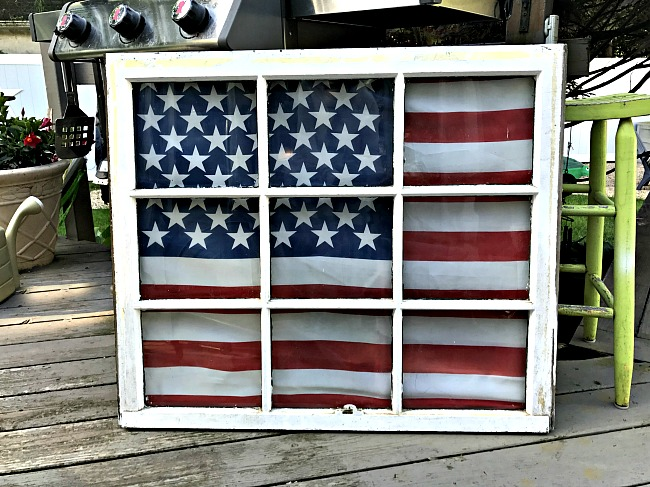 American flag on a chippy window