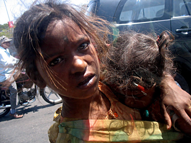 begging girl with baby