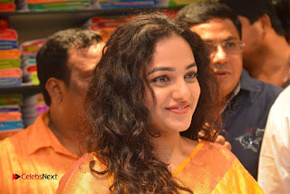 Actress Nithya Menen Pictures in Silk Saree at Kalamandir 25th Store Launch  0025