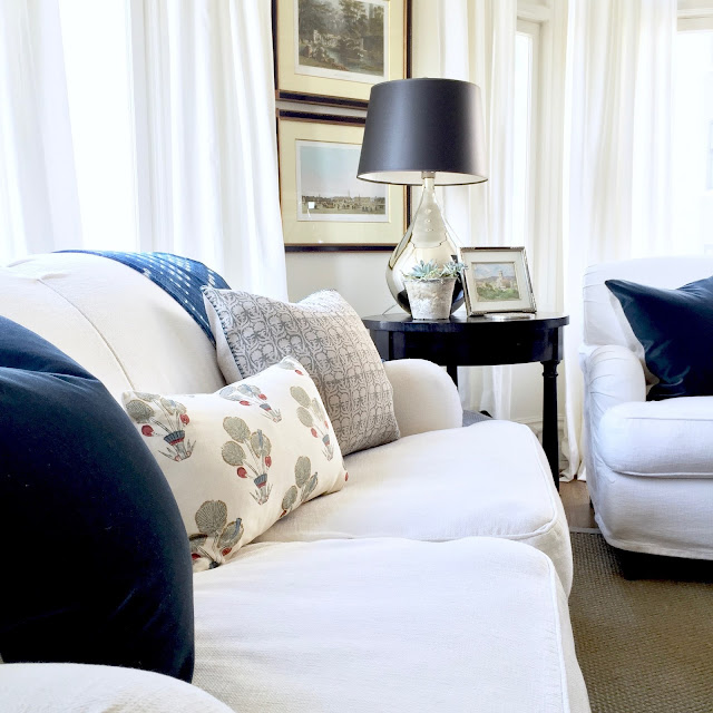 White sofas with blue and white pillows