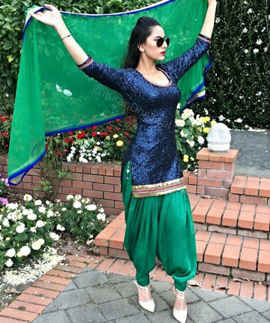 Beautiful girls in Party wear Green and Navy Punjabi suits