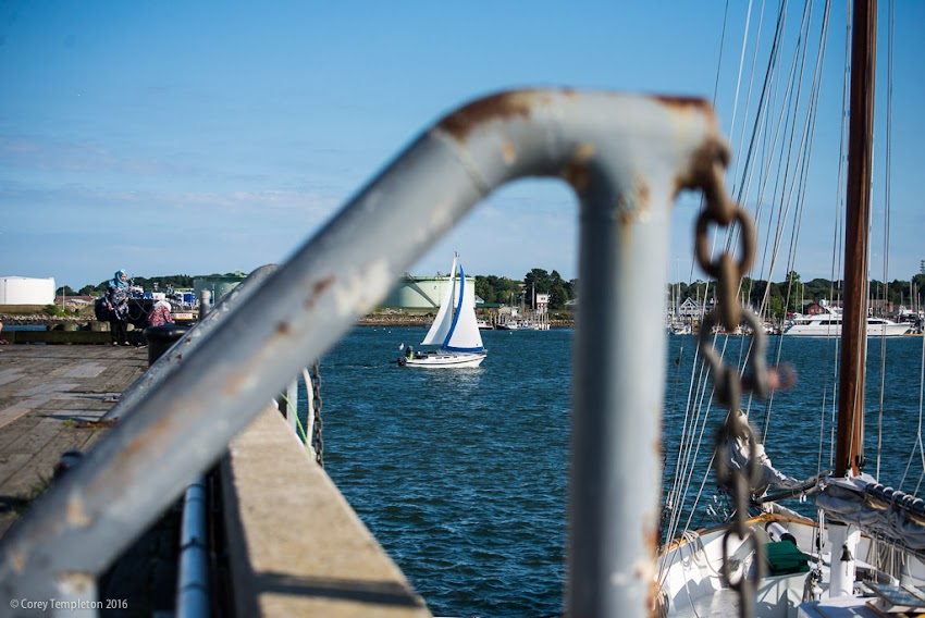 Portland, Maine USA August 2016 photo by Corey Templeton. A sailing vessel passing the State Pier on a sunny summer day.
