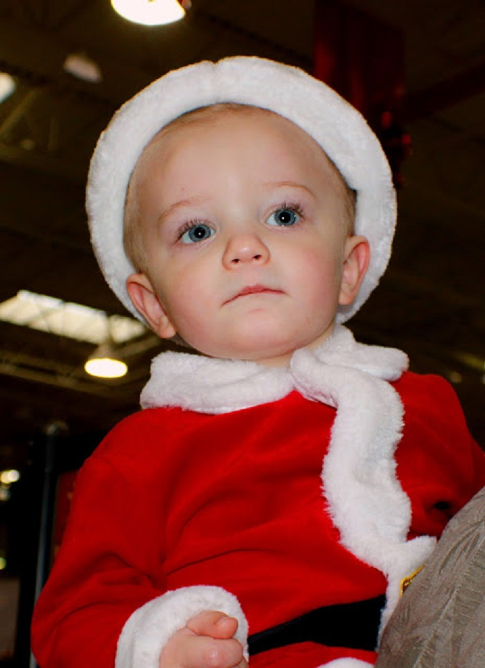 Antonio in his little Santa suit for Christmas at 22 months old