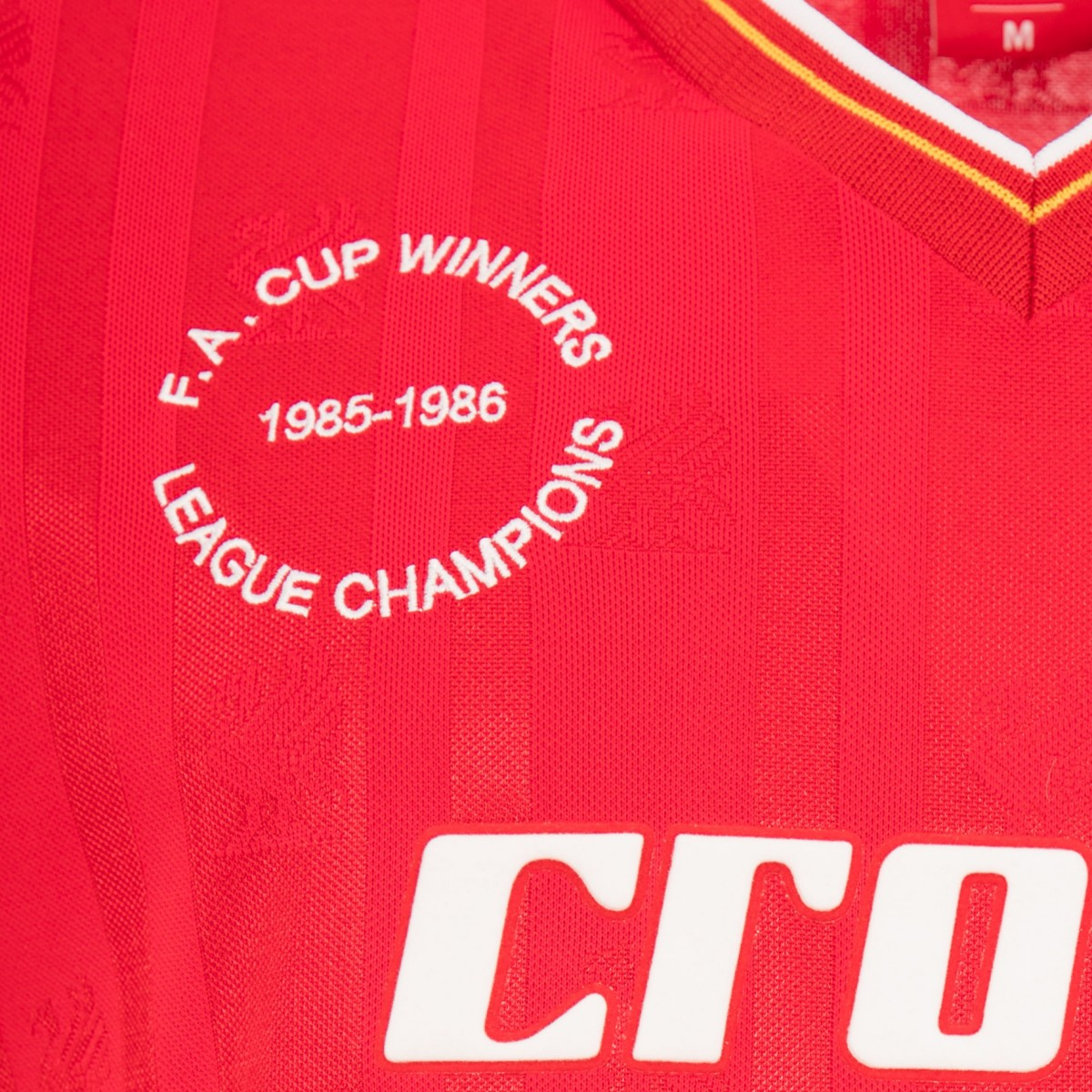 57437cb6 The LFC 1986 Home Shirt commemorates those victories with white embroidery  to the left of the chest.