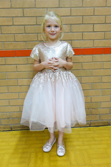 My daughter at her 6th birthday party wearing a pale pink sequin mesh dress from Little Dickens & Jones and shoes from H&M