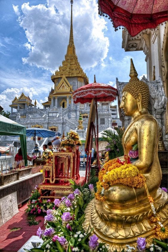 Futures - Buddha statue outside of Wat Traimit in Bangkok, Thailand.