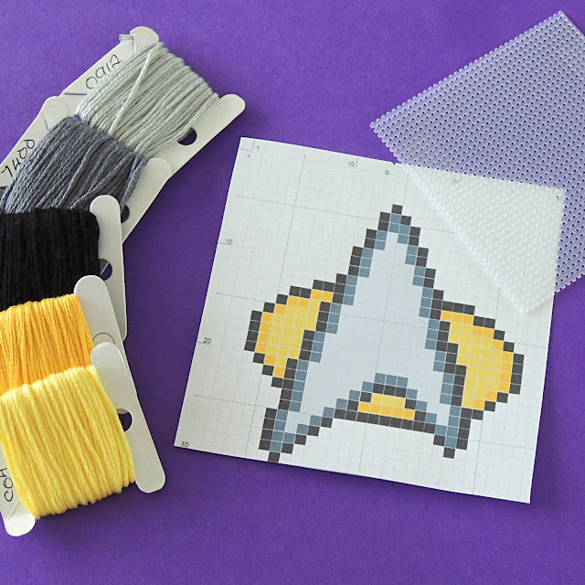DMC threads in yellow, black and grey, Star Trek Insignia Cross Stitch Chart and plastic canvas