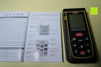Beschriftung: Laser-Entfernungsmesser, Jetery Digital Laser Distanzmessgerät Messung von Distanz, Flächen, Volumen|+/-2mm Messgenauigkeit|Laser Distanzmesser m/in/ft IP54 Schutz mit LCD Display, Wasserwaage, Batterien, Schutztasche (40M)