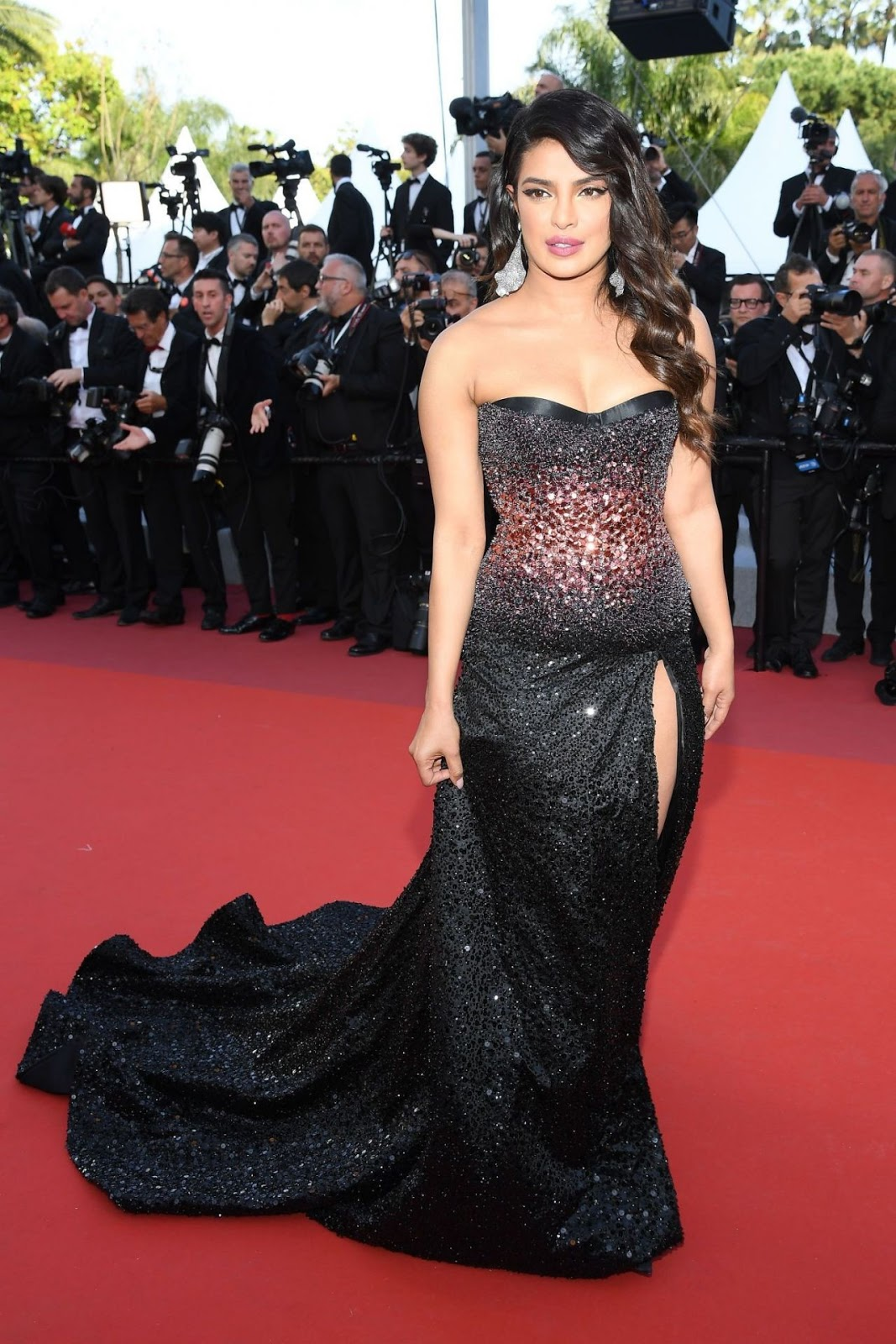 Priyanka Chopra Makes Her Cannes Debut in a Glittering Black High Leg Slit Dress