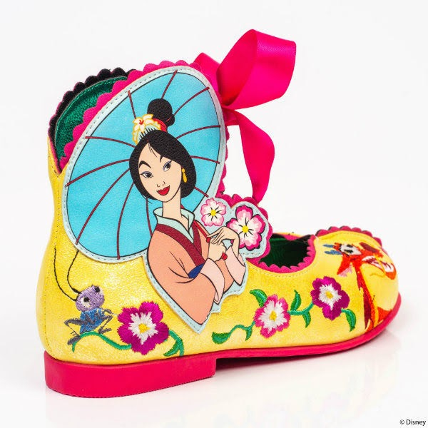 yellow Mulan kids shoe with embroidered detail and pink heel