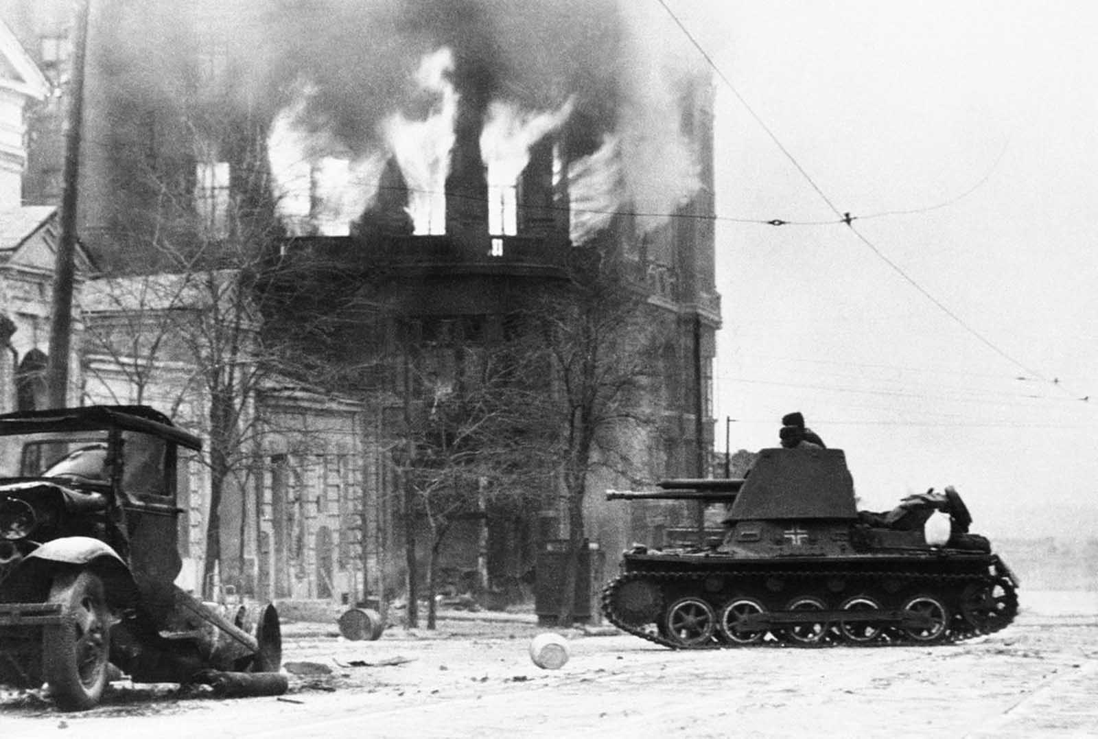 Burning houses, ruins and wrecks speak for the ferocity of the battle preceding this moment when German forces entered the stubbornly defended industrial center of Rostov on the lower Don River, in Russia, on November 22, 1941.