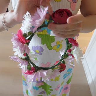 making a flower wreath to be worn as a spring crown