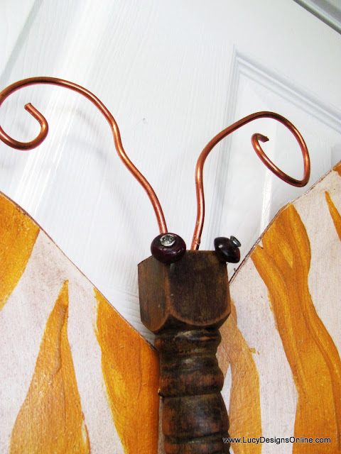 recycled butterfly with copper antenna