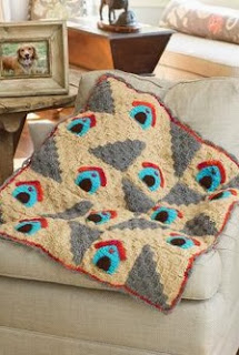http://www.redheart.com/free-patterns/dog%25E2%2580%2599s-home-throw