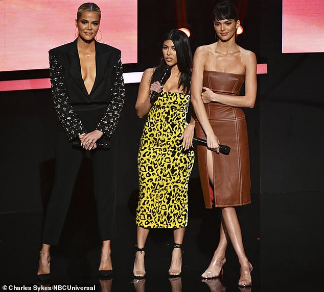 Kendall Jenner models leather dress at NBC Upfronts with Khloe and Kourtney Kardashian