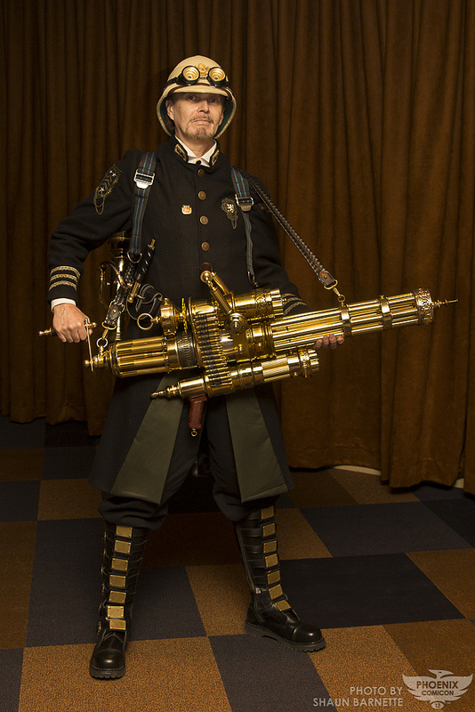 Man dressed in steampunk clothing, cosplaying as a member of the british royal army during the victorian era